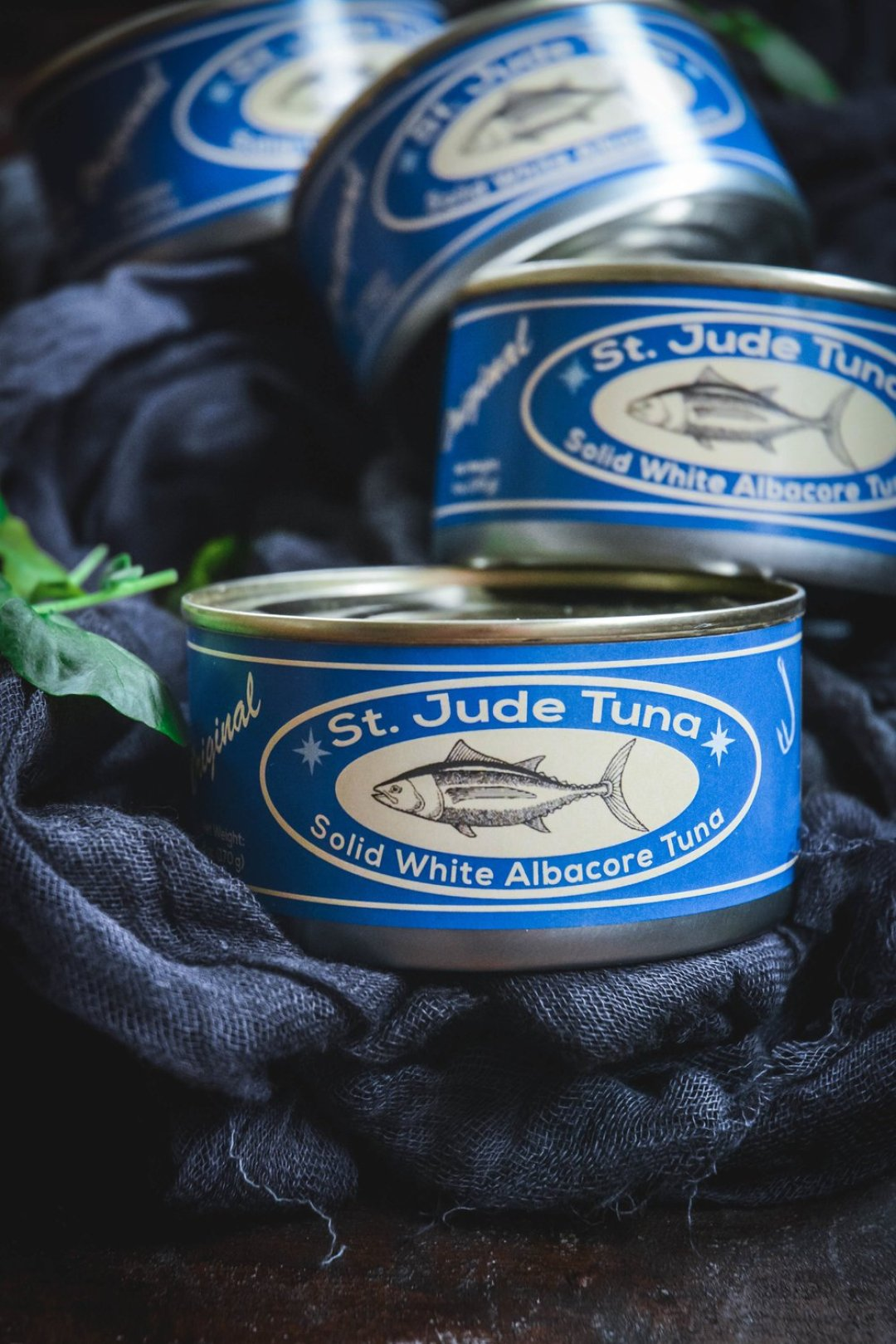 4 cans of st. jude tuna with blue labels